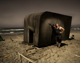 Artist Erik Peitersen with his Floating bunker